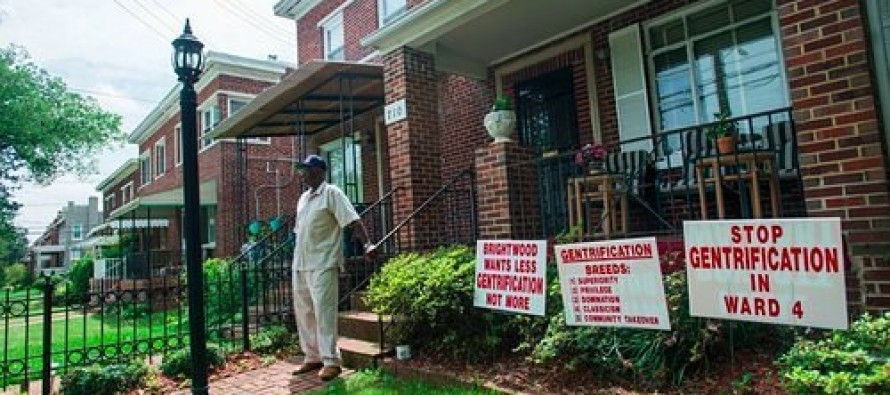 Black Man Upset Too Many White People Moving Into Neighborhood, Protests With Signs
