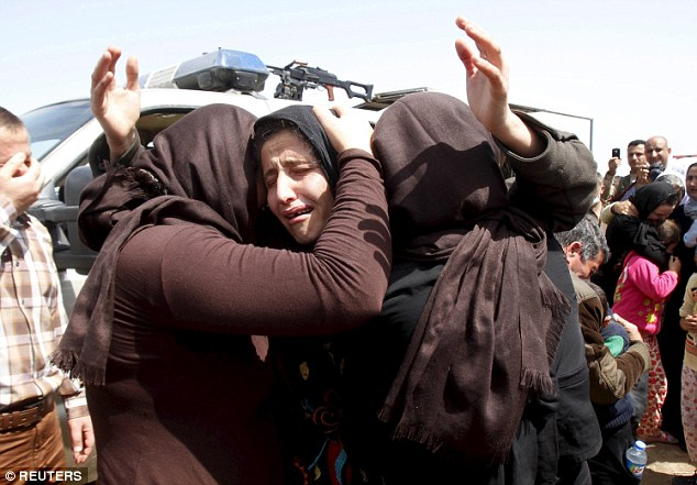 Members of the minority Yazidi sect who were freed by Islamic State militants hug each other on the outskirts of Kirkuk in Iraq in April 2015, having been held captive since last summer (file picture).