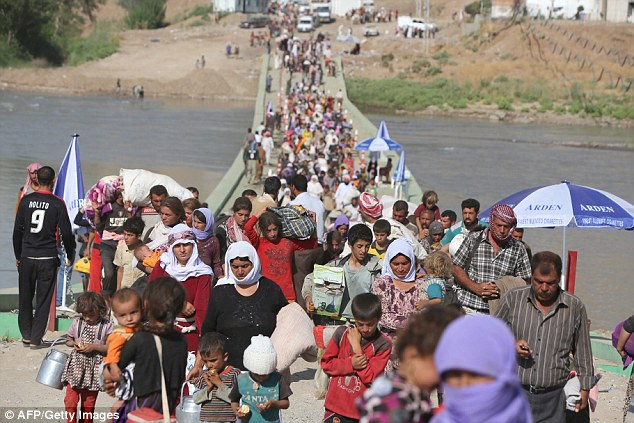 The beginning of slavery within the group dates back to this time last year, when ISIS fighters invaded villages near Mount Sinjar in Iraq. Displaced Iraqis from the Yazidi community are pictured in August 2014.