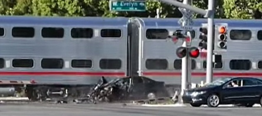 VIDEO: Officer Saves 'Drunk' Driver By Pulling Him To Safety Moments Before A Train Slammed Into His Car