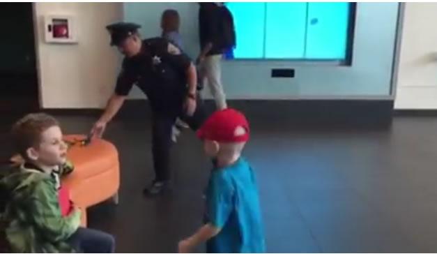 breakdancing cop and boy
