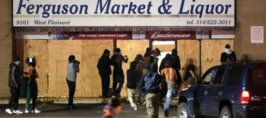 VIDEO: Protesters Flee When They See a Ferguson Store Owner is Packing Heat