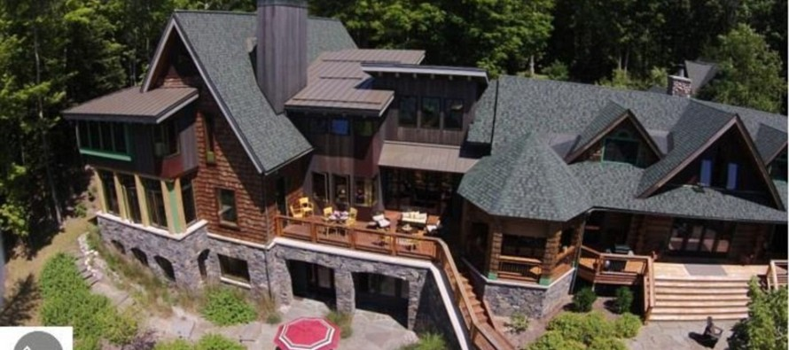 Hating Capitalism Pays Big: Michael Moore sells his log-palace mansion for $5 million