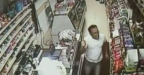 VIDEO: Cashier Fights off Sword Wielding Robbers...with a Bigger Sword!