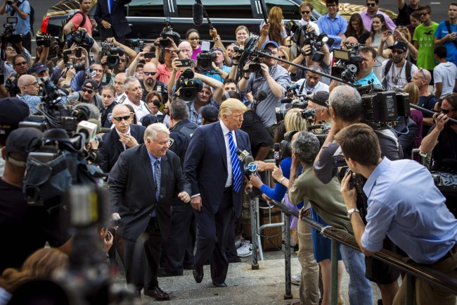 Trump is swarmed by media and fans when he appears for Jury Duty