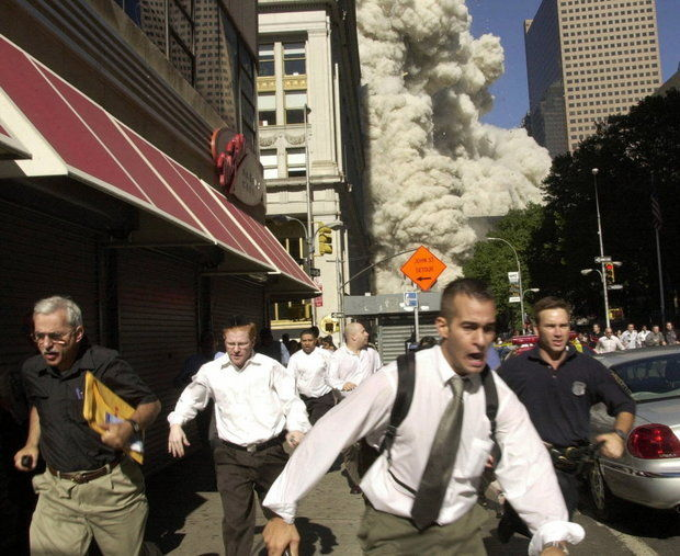 People run from the collapse of World Trade Center Tower in this Sept. 11, 2001, file photo. (AP Photo/Suzanne Plunkett)