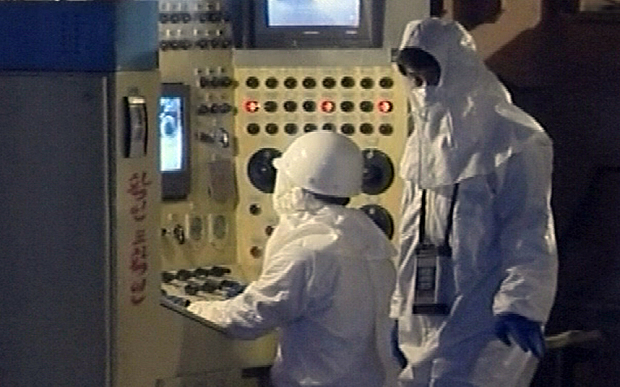Workers inside the main nuclear reactor in Yongbyon Photo: AP