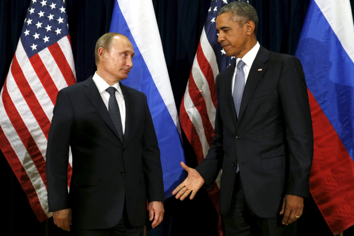 U.S. President Barack Obama extends his hand to Russian President Vladimir Putin during their meeting at the United Nations General Assembly in New York