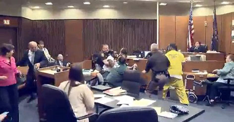 Chaos in the courtroom as father attacks his daughter's killer during sentencing hearing