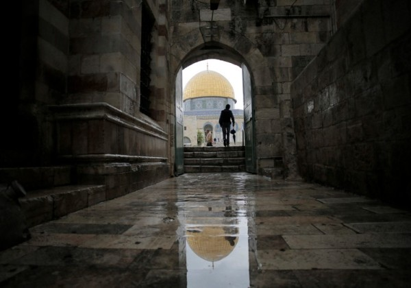 A visitor walks toward the Dome of the Rock as he enters the compound known to Muslims as Noble Sanctuary and to Jews as Temple Mount, in Jerusalem's Old City. (photo credit:REUTERS)