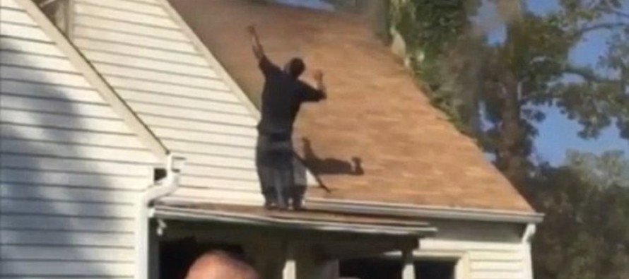 Bizarre VIDEO of Man Triumphantly Dancing on a Roof with a Knife After He Set Girlfriend's House on Fire