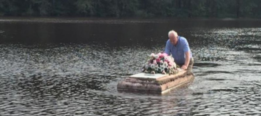 'This Is America': Defying Police orders SC Pastor Braves Floodwaters to Save Casket for Grieving Family