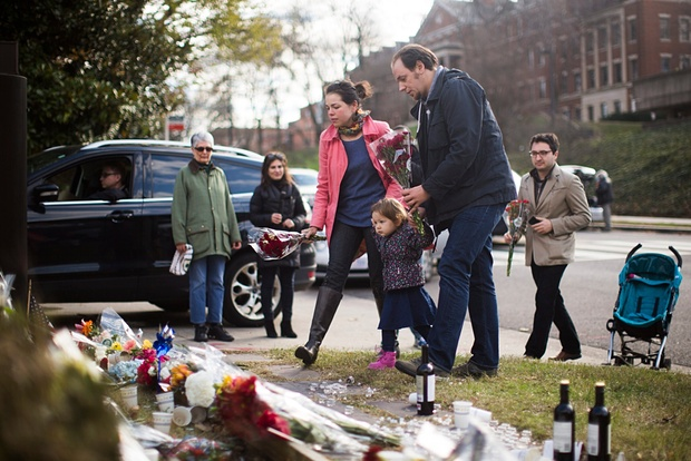 Visitors leave flowers at a memorial outside the French embassy in Washington DC in tribute to the victims of the Paris attack. Photograph: Jim Lo Scalzo/EPA
