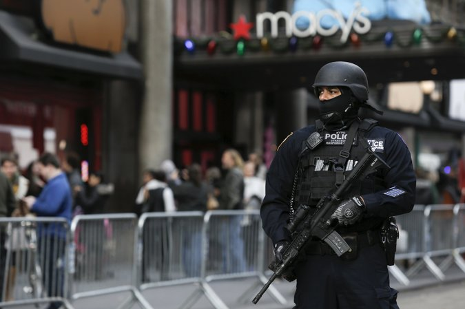 A member of the New York Police Department's Strategic Response Group outside Macy's this week as part of security preparations for the Thanksgiving Day parade. Credit Andrew Kelly/Reuters