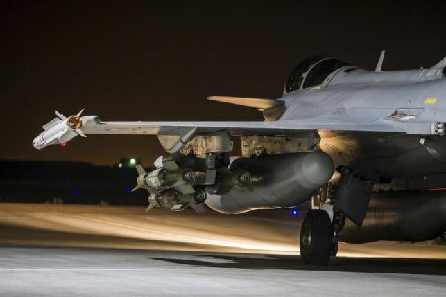 A French fighter jet is seen on the runway at an undisclosed location, in this picture released by the ECPAD