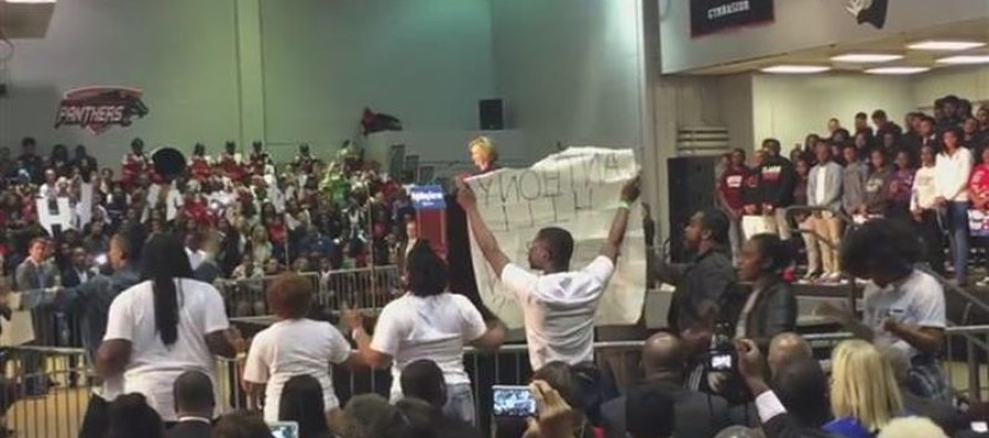 Hillary squirms awkwardly on stage for 30 min. as Black Lives Matter protesters shut down speech