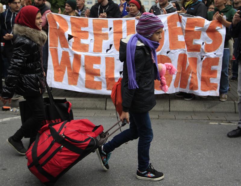 Migrants arrive at main railway station in Dortmund