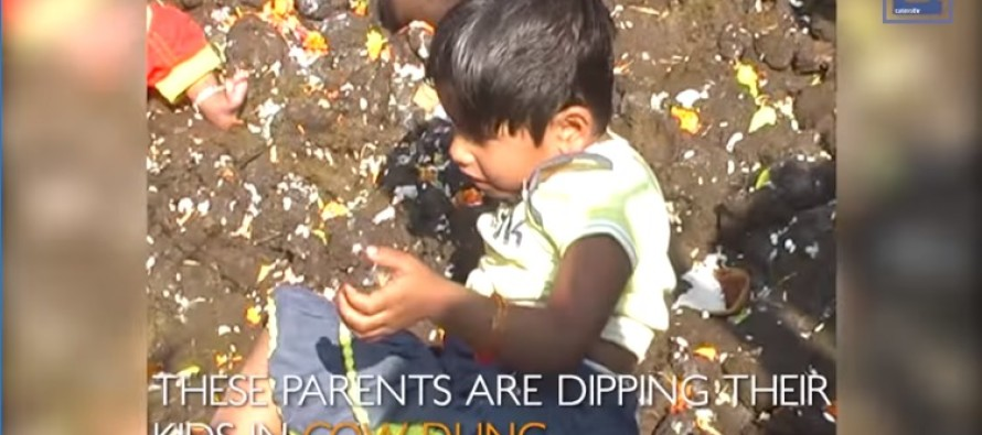 Video: Welcome to Multiculturalism! Indian Parents Dip Their Kids in Cow Dung for Luck