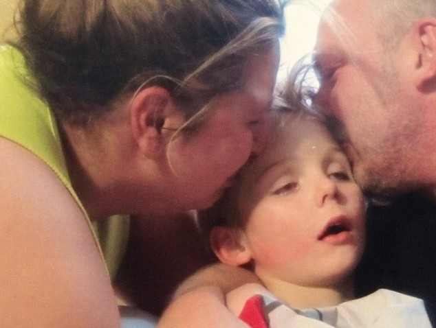 316A7FED00000578-3457012-Tragic_Cradled_in_the_arms_of_his_heartbroken_parents_this_harro-a-119_1456156999062