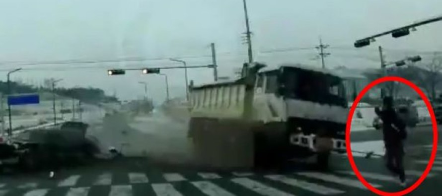 Video: Pedestrian dodges out of control dump truck by inches