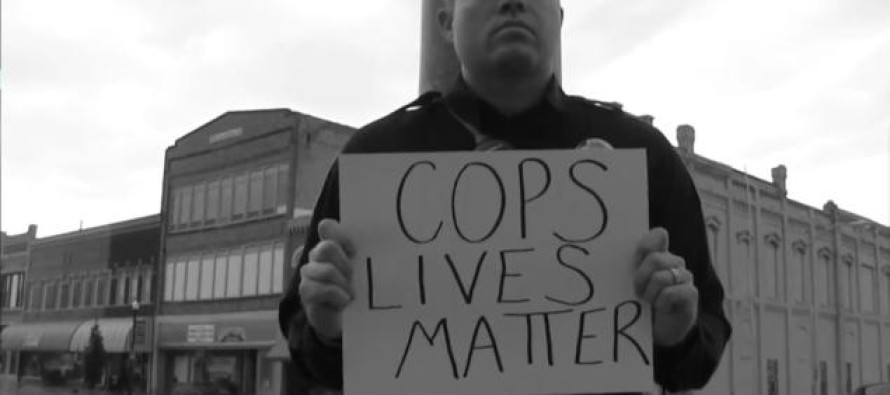 White Policeman Holds Sign That Says 'Cops Lives Matter' – Now He's Suspended.