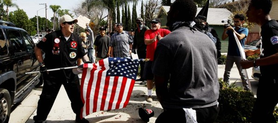 Man stabbed with flag pole as BLOODY hell breaks loose during KKK rally