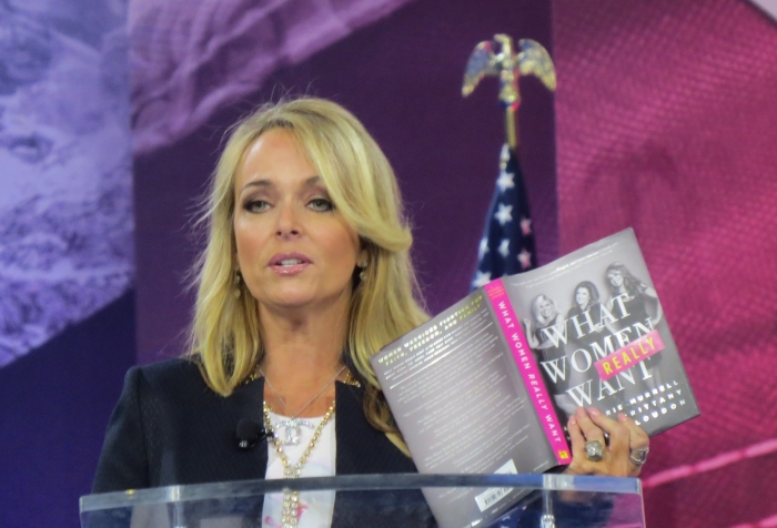 Gina Loudon speaks from the main stage at CPAC on Day 3