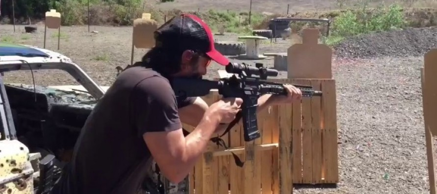 WATCH Keanu Reeves Shredding Firearms Like A BOSS