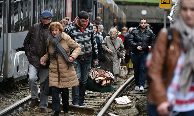People evacuate a tram during an anti-terrorist operation in Brussels on Friday. Photograph: Patrik Stollarz/AFP/Getty Images