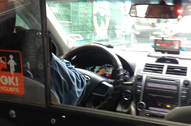 cab-driver-watching-TV
