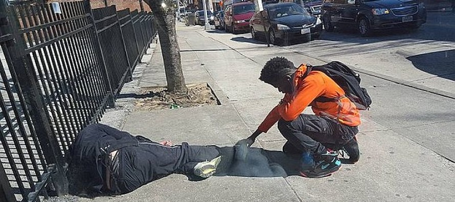 This Photo Is Going VIRAL of a Baltimore Teen Praying Over a Homeless Man
