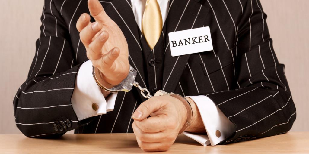 Banker in handcuffs