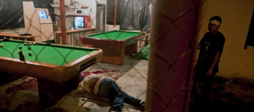 HORRIBLE! Gunmen disguised as policeman murder 12 in a pool hall