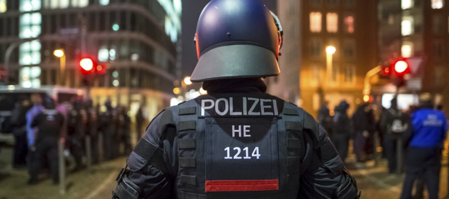 ALERT: Police Raid Homes of People Who Made Anti-Refugee Internet Posts in Germany