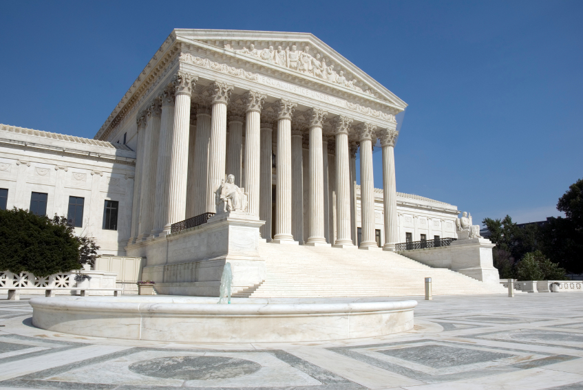 The front of the US Supreme Court in Washington, DC. Completed in 1935, the US Supreme Court building in Washington, DC, is the first to have been built specifically for the purpose, inspiring Chief Justice Charles Evans Hughes to remark, ÒThe Republic endures and this is the symbol of its faith.Ó The Court was established in 1789 and initially met in New York City. When the national capital moved to Philadelphia, the Court moved with it, before moving to the permanent capital of Washington, DC, in 1800. Congress lent the Court space in the new Capitol building, and it was to change its meeting place several more times over the next century, even convening for a short period in a private house after the British set fire to the Capitol during the War of 1812. The classical Corinthian architectural style was chosen to harmonize with nearby congressional buildings, and the scale of the massive marble building reflects the significance and dignity of the judiciary as a co-equal, independent branch of government. The main entrance is on the west side, facing the Capitol. On either side of the main steps are figures sculpted by James Earle Fraser. On the left is the female Contemplation of Justice. On the right is the male Guardian or Authority of Law. On the architrave above the pediment is the motto ÒEqual Justice under Law.Ó Capping the entrance is a group representing Liberty Enthroned, guarded by Order and Authority, sculpted by Robert Aitken. At the east entrance are marble figures sculpted by Hermon A. MacNeil. They represent great law givers Moses, Confucius, and Solon, flanked by Means of Enforcing the Law, Tempering Justice with Mercy, Settlement of Disputes between States, and Maritime and other functions of the Supreme Court. The architrave carries the motto ÒJustice the Guardian of Liberty.Ó The interior of the building is equally filled with symbolic ornamentation. The main corridor is known as the Great Hall and contains double rows of marble columns