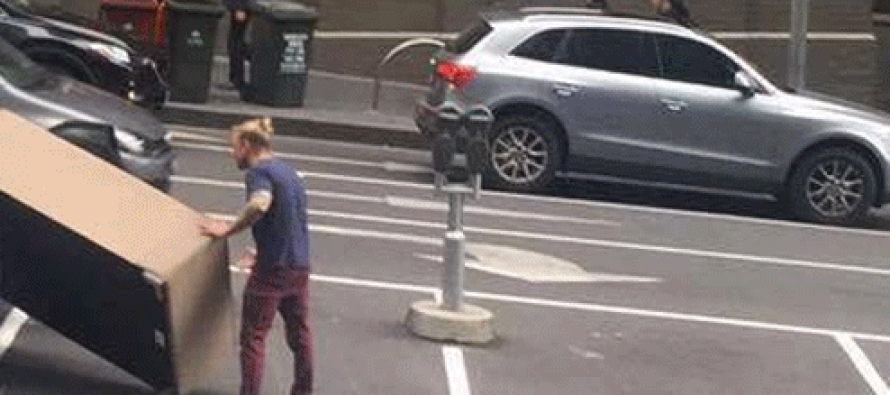 Hilarious Moment a Hipster Tries to Squeeze SOFA Into His Tiny Car & is Left Scratching His Man Bun