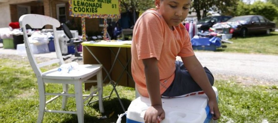 VIDEO: A 9 year-old boy has opened a lemonade stand to pay for his own adoption
