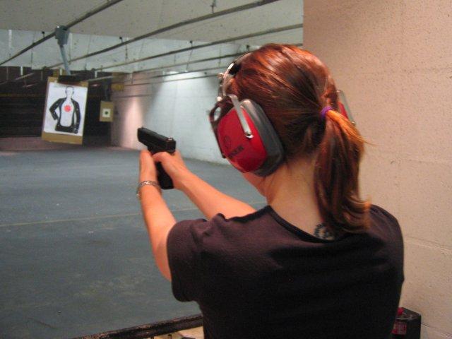 woman shooting range glock