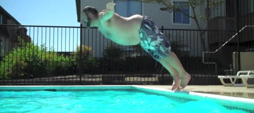 Hilarious Video Shows Giant Man Doing The World's Greatest Bellyflop Off of a Giant Waterslide
