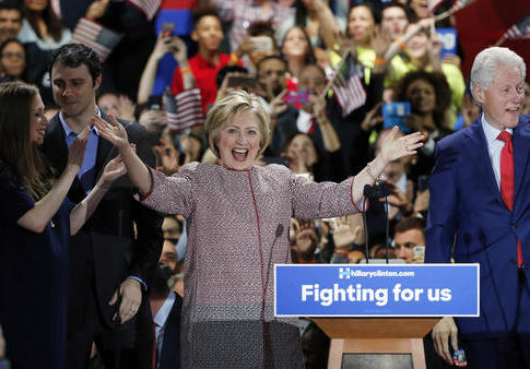 Democratic presidential candidate Hillary Clinton celebrates on stage with her family, from left, Chelsea Clinton, Mark Mezvinsky, and husband former president Bill Clinton, right, at her victory party after winning the New York state primary election Tuesday, April 19, 2016, in New York. (AP Photo/Kathy Willens)