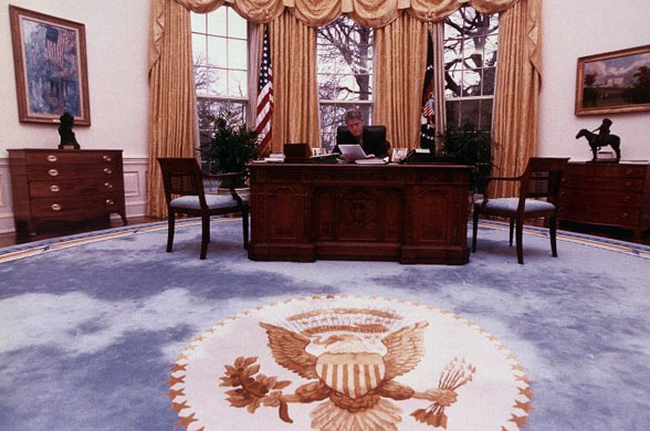 president bill clinton is shown in this undated photo delivering his first radio address to the bill clinton oval office