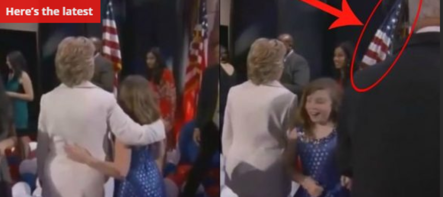 Hillary Sees Flag Fall To The Ground…See What She Does! [VIDEO]