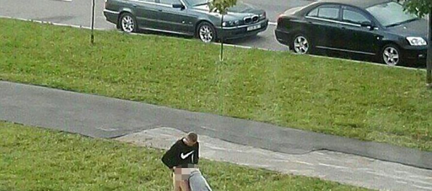 [WARNING GRAPHIC] Get a room! Grimy image goes viral of man having 'relations' with girlfriend…on SIDEWALK!
