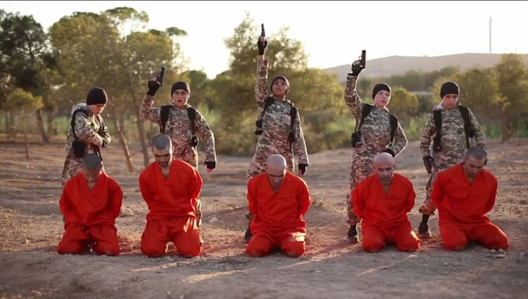 The British boy (second from the right) is identified as Abu Abdullah al-Britani Read more: http://www.dailymail.co.uk/news/article-3760598/Terrifying-new-ISIS-video-shows-British-boy-executing-prisoners-Syria.html#ixzz4IX64Up00  Follow us: @MailOnline on Twitter | DailyMail on Facebook