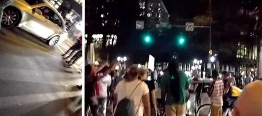 White Guy Walled In Car By BlackLivesMatter Protesters – They See What He's Brandishing And Scatter…
