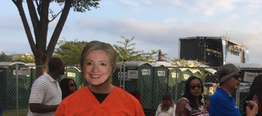 Anti-Hillary protester harassed for controversial sign and HORRIBLE mask