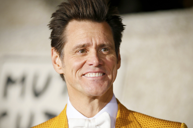 """Actor Jim Carrey poses at the world premiere of the film """"Dumb and Dumber To"""" in Los Angeles, November 3, 2014.   REUTERS/Danny Moloshok   (UNITED STATES - Tags: ENTERTAINMENT) - RTR4CPH0"""