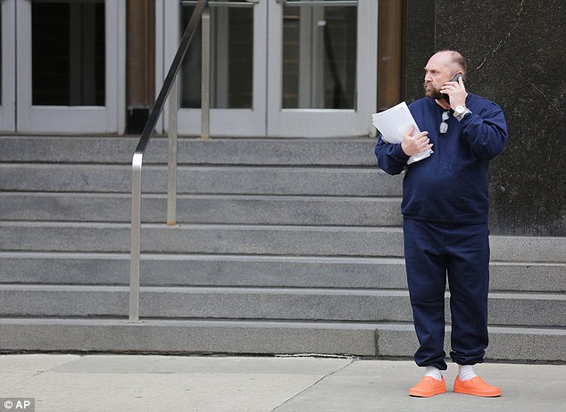 Arthur Rathburn (above, outside Theodore Levin United States Courthouse in Detroit in February) is accused of dismembering bodies and renting infected parts to medical researchers without the permission of the deceased's family.