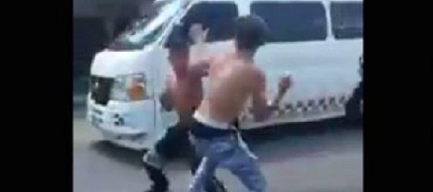 Two Teens FIST FIGHT In The Street…Until One Is RAN OVER By A Van! [VIDEO]