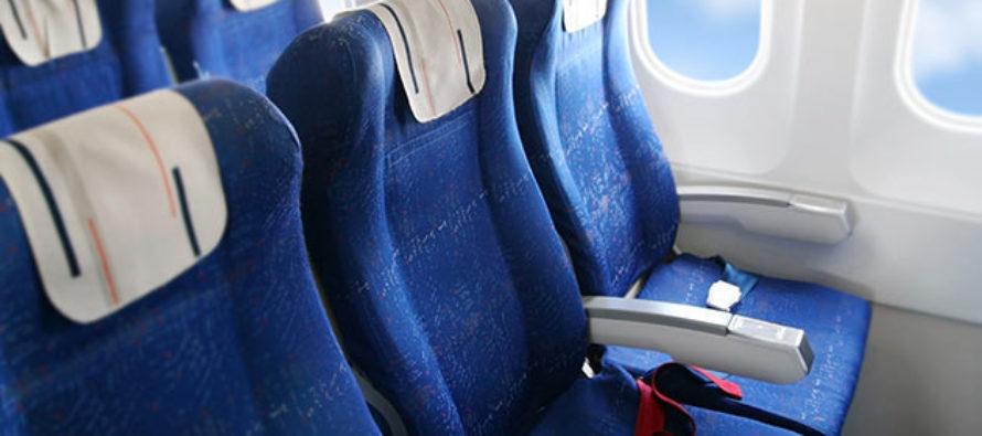 HAH! Passenger Secretly films himself claiming back an armrest on a flight, the reaction? Priceless! [VIDEO]